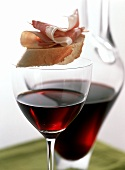 Red wine and canapé with Parma ham