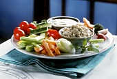 Raw salad platter with two dips