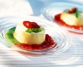 Vanilla blancmange with strawberry and basil sauce