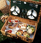 Picnic hamper with various dishes