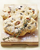 Focaccia with olives, dried tomatoes and thyme