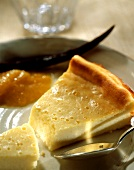 Piece of cheesecake with apricot compote
