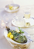 Stuffed trout wrapped in leeks with lemon and herb butter