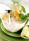Potato foam soup with basil diamonds
