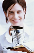 Young waitress serving food tin