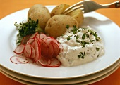 Boiled potatoes with herb quark and radishes