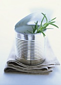 Sprig of fresh rosemary in food tin