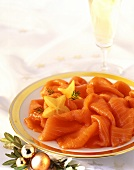 Smoked salmon and champagne glass with Christmas decoration