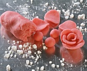 Pink marzipan rose and icing sugar