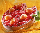 Cream gateau with jelly, peaches and rose petals