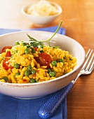 Saffron risotto with peas and cherry tomatoes