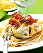 Crepe with quark, exotic fruit and icing sugar