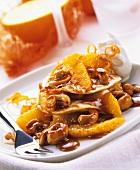 Mini-crepes with orange and cashew sauce