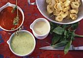 Three different pasta sauces and tortellini