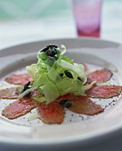 Veal carpaccio with celery and pumpkin seeds