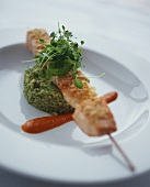 Salmon kebab on herb risotto with pepper sauce