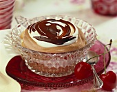 Layered dessert with chocolate crème and cream