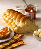 Bread plait with butter and jam
