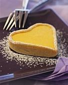 Heart-shaped lemon tartlet with icing sugar