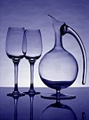 Two empty wine glasses and a carafe (blue-tinted)