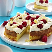 Raspberry gateau with cream and white chocolate curls