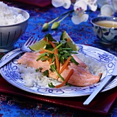 Salmon trout with vegetables, limes and rice