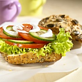 Vegetable burger with cucumber, tomatoes & sour cream