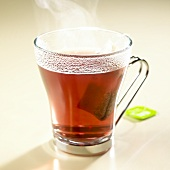 Hot herb tea with tea bag in glass
