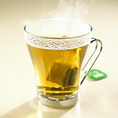 Hot peppermint tea with tea bag in glass