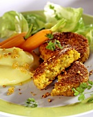 Carrot burgers with mashed potato and lettuce