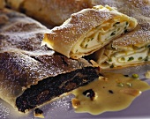 Poppy seed and curd cheese strudel with icing sugar