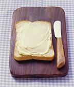 Buttered bread on bread board