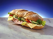 Baguette with ham, cheese, tomato and cucumber