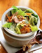Romaine lettuce with carrots, turkey breast and pine nuts