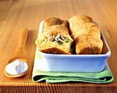 Potato rolls (Buchteln) with leeks, bacon and sour cream