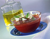 Tomato jelly with sheep's cheese and basil; olive oil