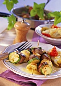 Grilled lamb and courgette kebabs with baked chicory