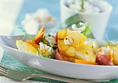 Fish curry with apples, coconut shavings and rice