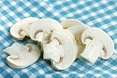 Mushroom slices on checked cloth