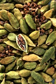 Cardamom capsules and seeds (filling the picture)