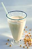 Glass of soya milk and soya beans