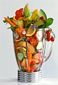 Fresh fruit and vegetables in blender