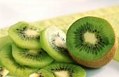 Kiwi fruit slices and half a kiwi fruit