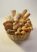 Loaves, bread rolls and sweet baked goods in bread basket