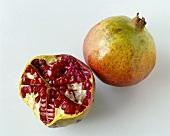 Whole and half pomegranate