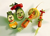 Amusing cucumber, courgette and carrot figures