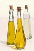Two bottles of olive oil & bottle of white wine vinegar