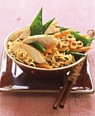 Egg noodle salad with sesame chicken and mangetouts