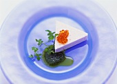 Salmon mousse with herb oil and trout caviare