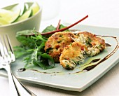Fish cakes with salad, wedge of lime